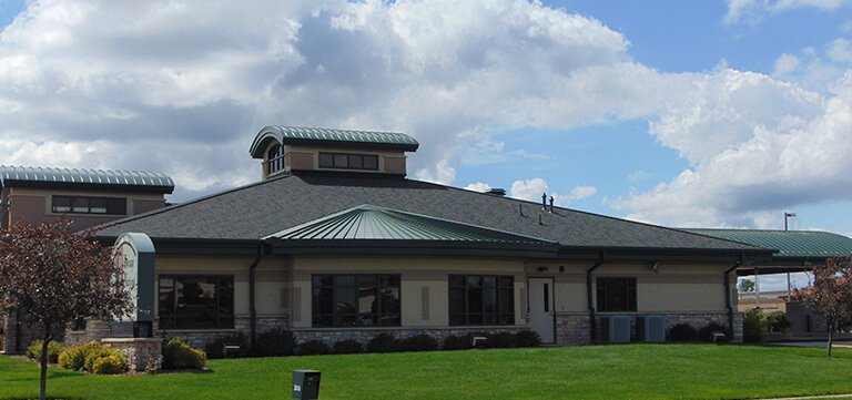 Metal , Shingle and Rubber Roofing on the Portage National Bank in Portage Wisconsin